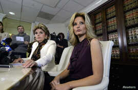 """Summer Zervos, a former contestant on the TV show """"The Apprentice,"""" reacts next to lawyer Gloria Allred, left, while speaking about allegations of sexual misconduct against Donald Trump during a news conference in Los Angeles, Oct. 14, 2016."""