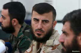 FILE - Zahran Alloush, founder of the Army of Islam, talks during a conference in Douma, Syria, Aug. 27, 2014. Alloush was killed Friday in a Russian airstrike on the his group's headquarters in Eastern Ghouta.