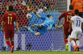 Spain's goalkeeper Iker Casillas dives trying to save a ball from Chile's Charles Aranguiz (not pictured) during their 2014 World Cup Group B soccer match at the Maracana stadium in Rio de Janeiro June 18, 2014.