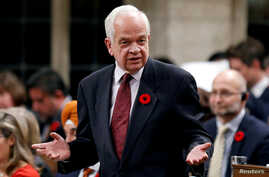 FILE - John McCallum, who at the time was Canada's immigration minister, speaks in the House of Commons on Parliament Hill in Ottawa, Ontario, Oct. 31, 2016. On Jan. 26, 2019, McCallum was fired as Canada's ambassador to China.