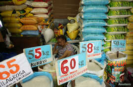 A vendor rests in her market stand that sells rice in Quezon City, Metro Manila in Philippines, Sept. 5, 2018.