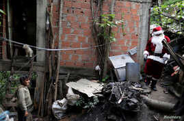 Santa Claus walks during a visit to residents of the slum of Petare in Caracas, Venezuela, Dec. 11, 2016.