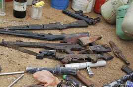 FILE - Confiscated weapons are displayed after a military raid on a hideout of suspected Islamist Boko Haram members in Nigeria's northern city of Kano August 11, 2012.
