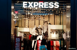 A customer walks past the Express store in Broomfield, Colorado, Aug. 28, 2013.