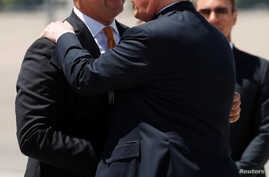 U.S. President Donald Trump is greeted by Sen. Dean Heller upon arrival in Las Vegas, June 23, 2018. The president was in Nevada to campaign for Heller.