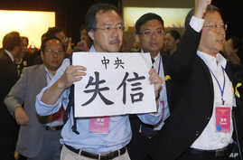 "FILE - Pro-democracy lawmaker Fernando Cheung holds a placard which reads "" Central Government break the promise "" as he protests against Li Fei, deputy secretary general of the National People's Congress Standing Committee, during a briefing sessi..."