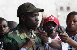The M23 rebels spokesperson Vianney Kazarama (C) speaks to the media at a stadium in Goma, November 21, 2012.