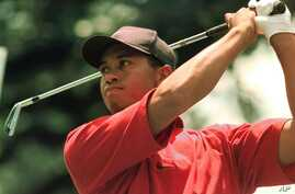 Tiger Woods drives off the third tee during the final round of the Western Open at Cog Hill Golf & Country Club in Lemont, Ill., Sunday, July 6, 1997.