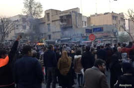People protest in Tehran, Iran, Dec. 30, 2017 in this still image from a video obtained by Reuters.