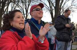 """Alison from Delaware joined in the chant """"Trump, Trump, Trump!"""" before the President elect and his family arrived at the Inaugural Welcome Concert. (C. Presutti/VOA)"""