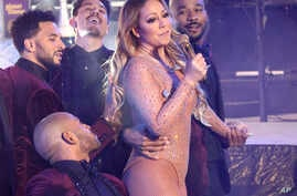 Mariah Carey performs at the New Year's Eve celebration in Times Square, Dec. 31, 2016, in New York.