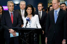 Surrounded by other supporting countries, United States Ambassador to the United Nations Nikki Haley (center) speaks to reporters outside the General Assembly at U.N. headquarters, March 27, 2017. Haley and the other representatives were not particip
