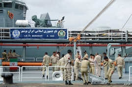 Iranian navy personnel stand aboard the IRIS Bushehr as two Iranian warships docked in the Sudanese Red Sea city of Port Sudan, Dec. 8, 2012.
