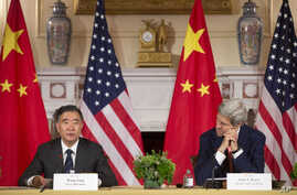 Secretary of State John Kerry, right, listens to China's Vice Premier Wang Yang, left, speak during the US China Closing Statements at US China Strategic and Economic Dialogue (S&ED) at the US State Department in Washington, Wednesday, June 24, 2015.