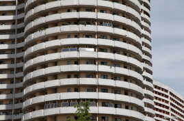 Solar panels face the sun from balconies of an apartment building in Mangyongdae district, Pyongyang, North Korea, August 27, 2014.