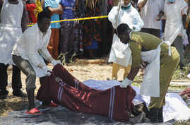 Tanzanian recovery workers remove bodies of victims of the MV Nyerere ferry distaster at in Lake Victoria, Tanzania, Sept. 22, 2018.
