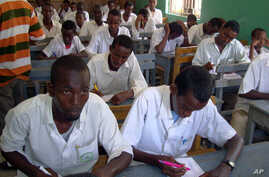 FILE - Somali students attend their annual exam in Yusuf Kowneyn secondary school in Mogadishu, Somalia.