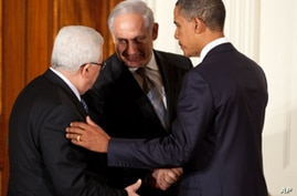 President Barack Obama talks with Palestinian President Mahmoud Abbas and Prime Minister Benjamin Netanyahu of Israel in the East Room of the White House, Sept. 1, 2010.