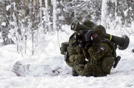 Estonian army soldiers attend the first live fire exercise of their new Javelin anti-tank missiles in Kuusalu, Estonia, Jan. 22, 2016.