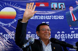 FILE - Kem Sokha, leader of the Cambodia National Rescue Party (CNRP), greets his supporters at headquarters before he goes to register for next year's local elections, in Phnom Penh, Cambodia, Oct. 5, 2016.