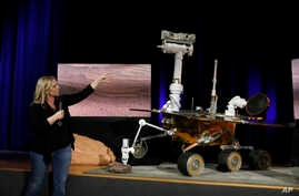 Mars 2020 project system engineer Jennifer Trosper points to a replica of the Mars rover Opportunity during a mission briefing at NASA's Jet Propulsion Laboratory, Feb. 13, 2019, in Pasadena, Calif.