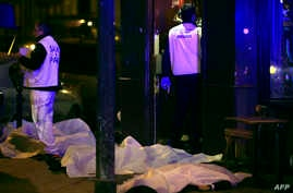 Victims lay on the pavement in a Paris restaurant, Nov. 13, 2015.