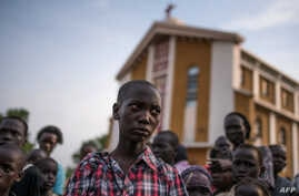 Steven, a young orphaned boy from the recent fighting who has lost his family stands on July 12, 2016 in Juba.