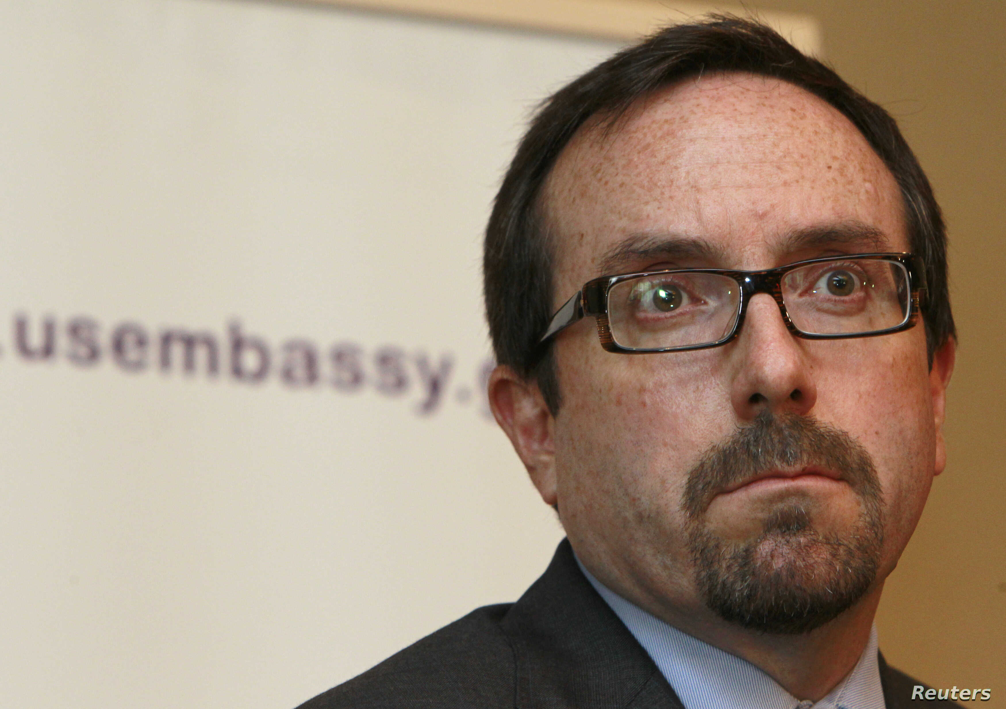 John Bass, shown while serving as U.S. ambassador to Georgia on June 28, 2012, attends a news conference in Tbilisi. Bass - the current ambassador to Turkey - is upset by Ankara's arrest of  U.S. employee Metin Topuz.