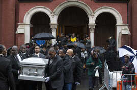 FILE - Pallbearers carry the casket of Akai Gurley during his funeral in Brooklyn, N.Y., in December; New York City Police Officer Peter Liang has been indicted in the fatal shooting of Gurley.