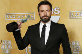 """Director and actor Ben Affleck holds the award for outstanding performance by a cast in a motion picture for """"Argo"""" at the 19th annual Screen Actors Guild Awards in Los Angeles, California January 27, 2013."""