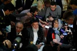Participants of the conference on Afghanistan including representatives of the Afghan authorities and the Taliban speak to journalists in Moscow, Russia, Nov. 9, 2018.