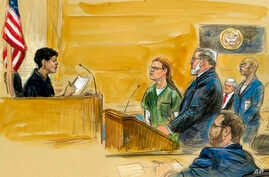FILE - In this courtroom sketch, Maria Butina (L) is shown next to her attorney Robert Driscoll, before U.S. District Judge Tanya Chutkan, during a court hearing at the U.S. District Court in Washington, Dec. 13, 2018.