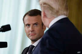 President Donald Trump speaks during a news conference with French President Emmanuel Macron in the East Room of the White House, April 24, 2018, in Washington.