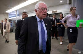 FILE - Democratic presidential candidate Sen. Bernie Sanders, I-Vt. heads to the Senate chamber on Capitol Hill in Washington, June 26, 2016. Sanders supporters failed to include language opposing the Trans-Pacific Partnership trade deal in a draft o