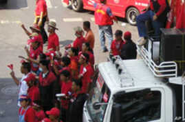 Rally leaders use a sound truck to encourage protesters, 06 Apr 2010