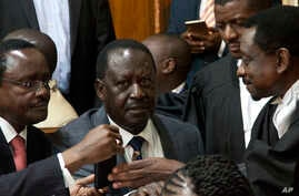 FILE - Opposition presidential candidate Raila Odinga (C) and his running mate, Kalonzo Musyoka (L), with their lawyer James Orengo (R), are seen at the Kenya Supreme Court, in Nairobi, Sept. 1, 2017.