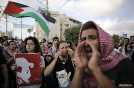 Israeli Arabs take part in a protest in the northern city of Acre July 7, 2014. The abduction and killing of Palestinian teenager Mohammed Abu Khdeir has touched off clashes between police and stone-throwing Arab protesters in East Jerusalem and in s