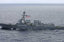 FILE - The USS Chafee, a US Navy destroyer which operates 100 percent on biofuel, sails about 150 miles (241 km) north of the island of Oahu during Naval exercises off Hawaii, July 18, 2012.