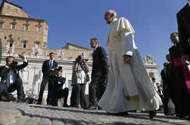 Pope Francis arrives to lead his Wednesday general audience in Saint Peter's square at the Vatican, Sept. 25, 2013.