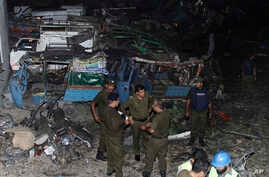 Pakistani security personnel visit the site of a blast in Lahore, Pakistan, Aug. 7, 2017.