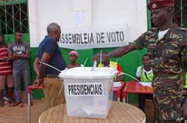 A Guinea-Bissau soldier cast's his ballot at a polling station in Bissau, Guinea-Bissau,  May 18, 2014.