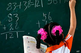China Reviews Public Education