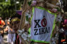 Revelers wearing Greek style costumes raise awareness of the need to prevent the spread of the Zika virus in the first carnival ''Bloco'' (street parade group) under the theme ''Rio: The Olympics are here'' on the streets of  Rio de Janeiro, Brazil o