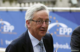 Candidate for the European Commission presidency Jean-Claude Juncker arrives at an European People's Party (EPP) meeting in Brussels, ahead of an informal dinner of EU leaders, May 27, 2014.
