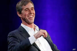 """Former Democratic Texas congressman Beto O'Rourke laughs during an interview with Oprah Winfrey on a Times Square stage at """"SuperSoul Conversations,"""" Feb. 5, 2019, in New York. O'Rourke dazzled Democrats in 2018 by nearly defeating Republican Sen. Te"""