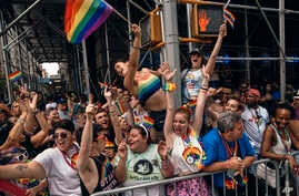 People cheer as floats travel along Fifth Avenue during the New York City Pride Parade, June 25, 2017.