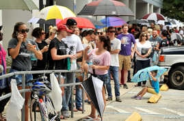 Hundreds of community members line up outside a clinic to donate blood after an early morning shooting attack at a gay nightclub in Orlando, Fla., June 12, 2016.