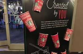Starbucks holiday cups appear on display Nov. 8, 2016, at a store in New York. Snowflakes, reindeer and candy canes are back on Starbucks holiday coffee cups, after last year's plain red cups caused uproar from critics who said the chain was part of