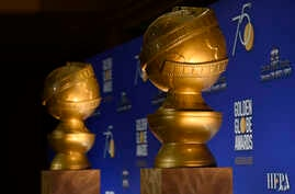 FILE -  Golden Globe statues appear on stage prior to the nominations for 75th Annual Golden Globe Awards at the Beverly Hilton hotel in Beverly Hills, Calif., Dec. 11, 2017.