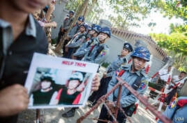 Police block protestors outside the Thai embassy in Yangon.